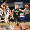 Shane Jenkins, of Westside, left, quards Christian Frye, of Winfield, as he brings the ball up court in the second quarter during the quarter-final game of the Class AA Boys State Basketball Tournament held at the Charleston Civic Center. Winfield won 68-65<br /> (Rick Barbero/The Register-Herald)
