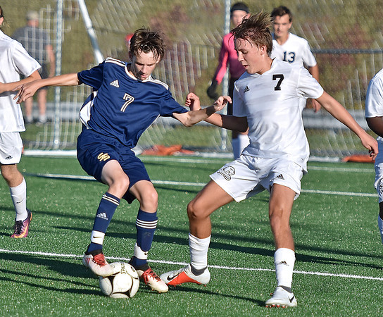 (Brad Davis/The Register-Herald) Shady Spring's Caleb Lilly battles for possession with Bluefield's Braeden Crews Thursday evening at the YMCA Paul Cline Memorial Sports Complex.
