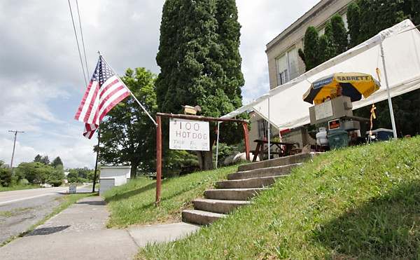 Dave's hot dog stand is one of the few remaining businesses in Renick. He rents the space on the grounds of the old high school, which stands empty. (Jenny Harnish/The Register-Herald)