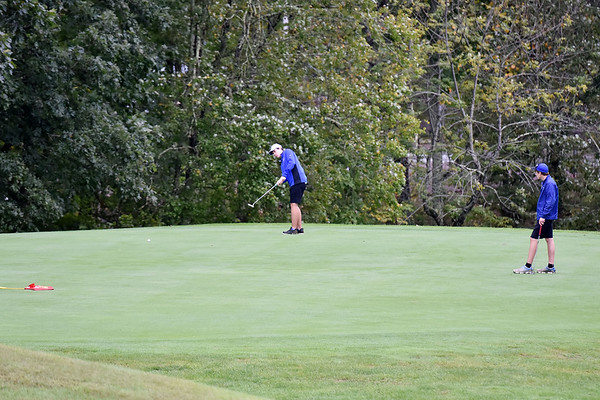 A pair of Princeton players putt on the No. 18 green during their Class AAA, Region 3 golf tournament at Pipestem Resort State Park on Monday. (Chris Jackson/The Register-Herald)
