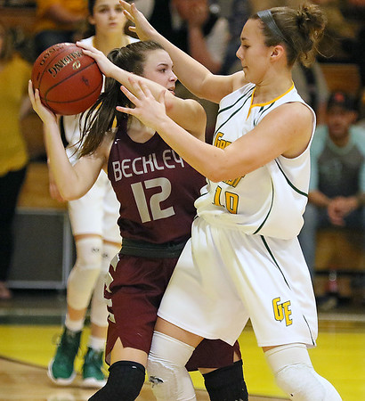(Brad Davis/The Register-Herald) Woodrow Wilson's Cloey Frantz is smothered by relentless pressure from Greenbrier East's Abbie Bartenslager Saturday night in Fairlea.