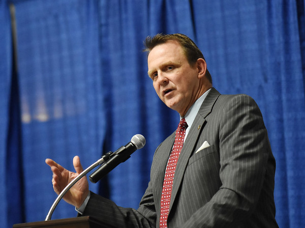 West Virginia University Athletic Director Shane Lyons speaks about growing up in West Virginia, leaving the state for work, than coming back to WVU during the 98th annual Beckley-Raleigh County Chamber of Commerce Annual Dinner at the convention center in Beckley Friday.(Chris Jackson/The Register-Herald)