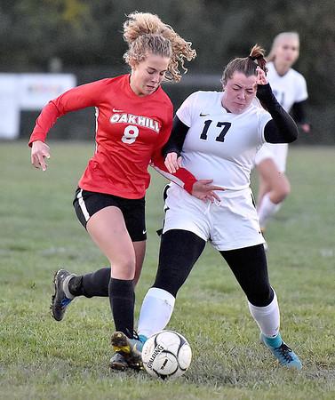 (Brad Davis/The Register-Herald) Oak Hill's Kiya Babkirk tries to get around PikeView defender Sarah Stamper Wednesday night in Oak Hill.