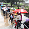 Teacher and service personnel stand in the rain preparing for a rally at the State Capitol in Charleston during Day 6 of the teachers walkout.<br /> (Rick Barbero/The Register-Herald)