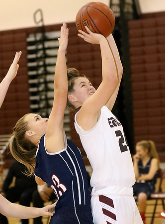 (Brad Davis/The Register-Herald) Woodrow Wilson's Elizabeth Cadle drives to the basket as Independence's Mackenzie Holley defends during the Lady Eagles' win on Hall of Fame Friday night.
