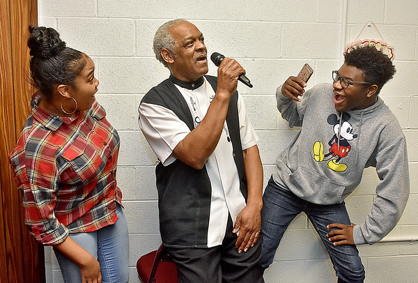 (Brad Davis/The Register-Herald) Students react to encountering musician Bill Withers (played by Sidney Catus) in the wax museum as they rehearse scenes from Blacks in Wax Saturday afternoon at Heart of God Ministries.