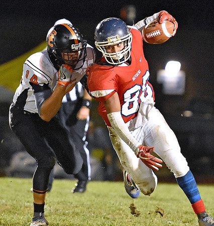 (Brad Davis/The Register-Herald) Independence's Nico Burgess carries the ball as Summers County's Christian Pack tries to bring him down Friday night in Coal City.