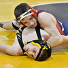 (Brad Davis/The Register-Herald) Independence's Bryce Perdue takes on Keyser's Tyler Skaggs in a 113-pound weight class matchup during state wrestling tournament action Thursday night at Huntington's Big Sandy Arena.