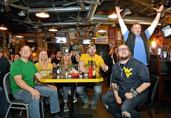 (Brad Davis/The Register-Herald) Fans of both schools react to events on the court as Marshall and West Virginia square off in the NCAA Tournament's second round late Sunday night.