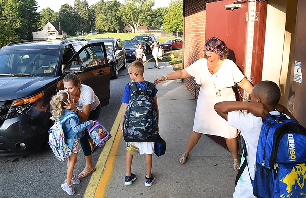 Crescent Elementary School Principal Theresa Lewis, right, directs students in the school during parent drop off for the first day of school in Raleigh County.<br /> (Rick Barbero/The Register-Herald)