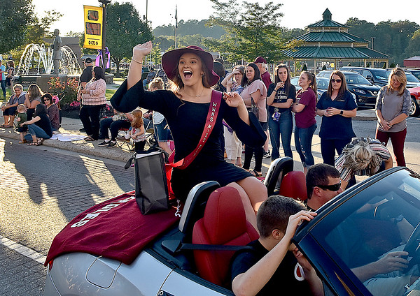 (Brad Davis/The Register-Herald) Homecoming court participant Adrian Coalson waves to friends and family in the crowd during the school's homecoming parade Wednesday evening in downtown Beckley.