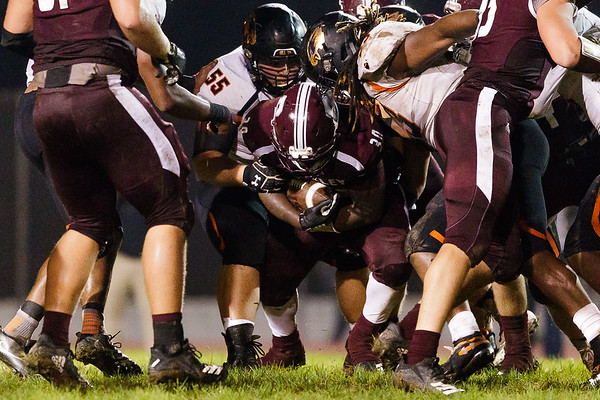 Woodrow Wilson's Martay Lee carries the football and half of the South Charleston defensive line down the field. Chad Foreman for the Register-Herald.