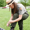 Park Ranger Angela Allison ties her boot before taking dozens of eager hikers on a night hike along the Rim and Turkey Spur trails at Grandview as part of Active SWV's and the National Park Service's Get Active in the Park Tuesday in Grandview. (Chris Jackson/The Register-Herald)