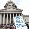 Student lead rally on the State Capital steps in Charleston supporting their teachers during Day 7 of their walkout. Students also marched around the Capitol building.<br /> (Rick Barbero/The Register-Herald)