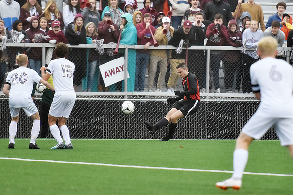 University's Michael Bakos (5) delivers a free-kick during their Class AAA semifinal game against George Washington Friday in Beckley. (Chris Jackson/The Register-Herald)