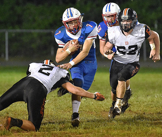 (Brad Davis/The Register-Herald) Midland Trail's Colton Yoder carries the ball as Richwood defenders Braden Snyder, left, and Zachery Bailey try to bring him down Friday night in Hico.