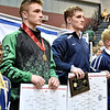 (Brad Davis/The Register-Herald) Fayetteville's Trent Pullens, left, and Independence's Connor Gibson at the Class A/AA 160-pound weight class podium during State Wrestling Tournament action Saturday night at the Big Sandy Arena.