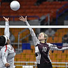 (Brad Davis/The Register-Herald) Woodrow Wilson's Kacee Fansler taps the ball back over as University's Kaliegh Brooks tries to block during State Volleyball Tournament action Friday evening at the Charleston Civic Center.