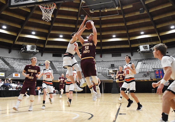 Pocahontas County's  Jarrett Taylor (50) puts up a layup over Richwood's (14) during their Big Atlantic Classic basketball game Monday in Beckley. (Chris Jackson/The Register-Herald)