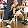 (Brad Davis/The Register-Herald) Greenbrier West's Noah Midkiff drives along the perimeter as Independence's Blake Stone defends Friday night in Coal City.
