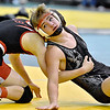 (Brad Davis/The Register-Herald) Liberty's Davy Stoots takes on Sissonville's Hunter Whittington in a 120-pound weight class matchup during state wrestling tournament action Thursday night at Huntington's Big Sandy Arena. Liberty's Stoots won the match.