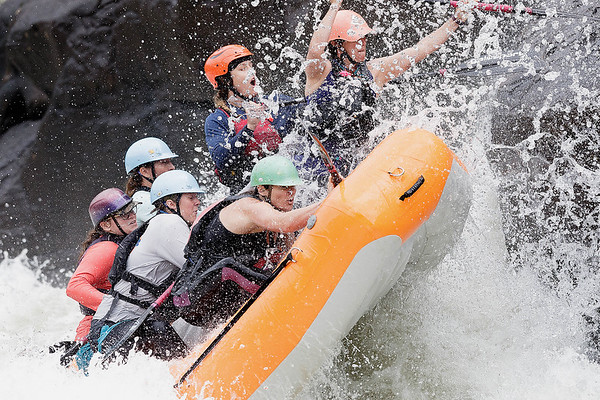 """The """"Sweets of the East"""" perform a high-side to keep their raft from flipping as they climb up a pillow of water in Pillow Rock Rapid on the Upper Gauley. The """"Sweets"""" are an all-women raft team made entirely of local female raft guides. This is a practice run for the downriver race which takes place on the Upper Gauley River today. Chad Foreman for the Register-Herald."""