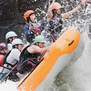 "The ""Sweets of the East"" perform a high-side to keep their raft from flipping as they climb up a pillow of water in Pillow Rock Rapid on the Upper Gauley. The ""Sweets"" are an all-women raft team made entirely of local female raft guides. This is a practice run for the downriver race which takes place on the Upper Gauley River today. Chad Foreman for the Register-Herald."
