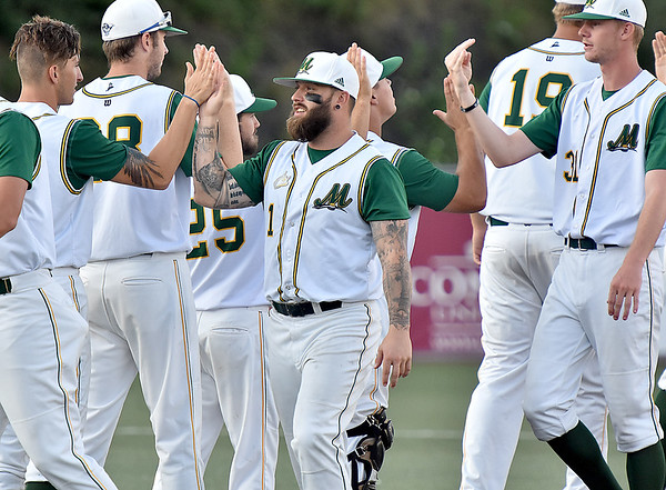 (Brad Davis/The Register-Herald) Miners players congratulate one another after a win in the first game of a doubleheader against Terre Haute Wednesday night at Linda K. Epling Stadium.