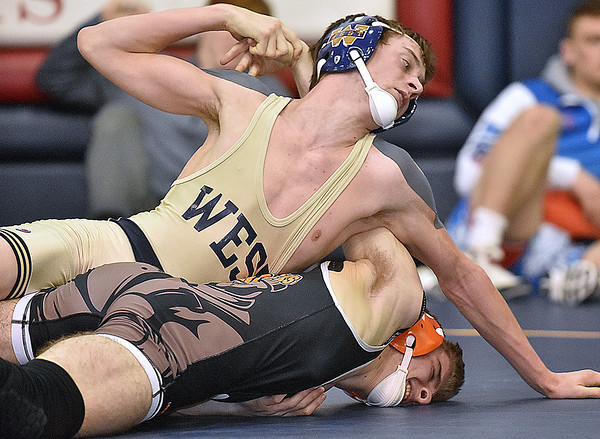 (Brad Davis/The Register-Herald) Greenbrier West's Dan Nutter takes on Richwood's Joseph Dudley in a 132-pound weight class matchup during the Class AA/A Regionals Saturday afternoon at Independence High School. West's Seldomridge won the match.