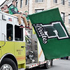 Fayetteville's Devon Dean holds the Fayetteville High School flag during their homecoming parade Friday in Fayetteville. (Chris Jackson/The Register-Herald)