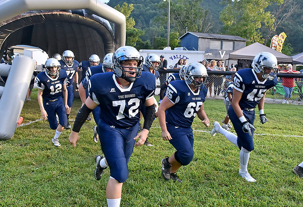 (Brad Davis/The Register-Herald) The Valley Greyhounds take the field for the school's final home opener Friday night in Smithers.