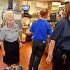 (Brad Davis/The Register-Herald) Retiring McDonald's manager Jessie Wolfe works behind the counter during a Register-Herald visit to her store Wednesday afternoon.