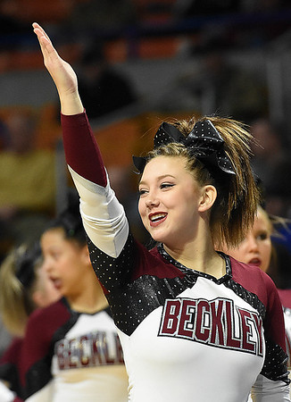 Woodrow Wilson cheerleader during game against Martinsburg in the quarter-final game of the Class AAA Boys State Basketball Tournament held at the Charleston Civic Center. Martingburg won 58-48<br /> (Rick Barbero/The Register-Herald)