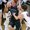 (Brad Davis/The Register-Herald) Princeton's Andrew Hopkins tries to cut between Woodrow Wilson defenders Josiah Walton, left, and Danny Bickey on his way to the basket during the Sectional Championship Friday night at the Beckley-Raleigh County Convention Center.