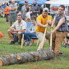 (Brad Davis/The Register-Herald) WVU Woodsman Team members A.J. frey, left, and J.T. Nicholson work together turning a heavy log around to go back in the opposite direction as they compete in timed log roll heats against Ohio State's Forestry Forum team during the Lumberjack Competition at the annual Lumberjackin' Bluegrassin' Jamboree Saturday morning at Twin Falls State Park.