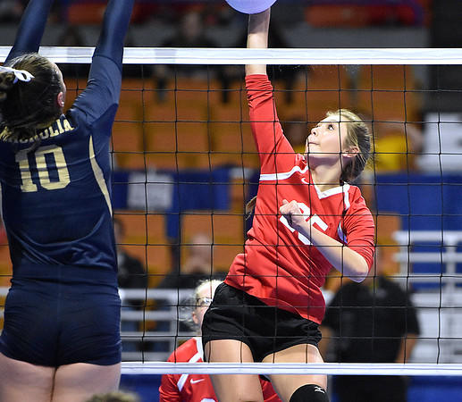 (Brad Davis/The Register-Herald) Greater Beckley Christian's Nevaeh Dickens hits the ball as Magnolia's Kyndra Pilant defends during State Volleyball Tournament action Friday evening at the Charleston Civic Center.