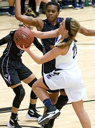 (Brad Davis/The Register-Herald) WVU Tech's Alexandra Combs drives and scores as Cincinnati Christian's Dan'Shea Hill defends Thursday night at the Beckley-Raleigh County Convention Center.