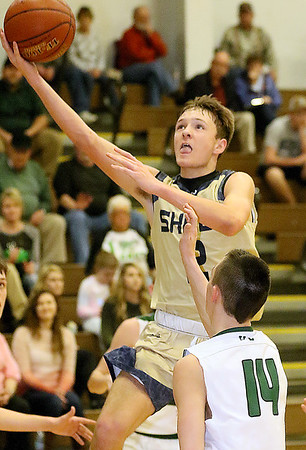 (Brad Davis/The Register-Herald) Shady Spring's Tommy Williams drives to the basket as Wyoming East's Caden Lookabill defends Friday night in New Richmond.