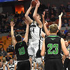 Corey Hatfield, of Westside, drives to the basket against two Winfield defenders in the quarter-final game of the Class AA Boys State Basketball Tournament held at the Charleston Civic Center. Winfield won 68-65<br /> (Rick Barbero/The Register-Herald)