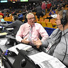 Fred Persinger, left and his son Fred Persinger II, broadcast the Boys State Basketball Tournament game together between Woodrow Wilson and Martinsburg for Metro News Radio Network Thursday at the Charleston Civic Center.<br /> (Rick Barbero/The Register-Herald)