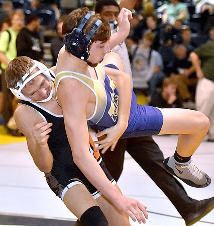 (Brad Davis/The Register-Herald) Greenbrier West's Trevor Edenfield and Richwood's Baily Alderman square off in a 145-pound weight class matchup Friday night at the Summersville Arena and Convention Center. West's Edenfield would win the match.