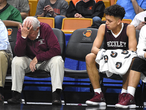 Woodrow Wilson asst. coach Dave Barksdale disappointed after losing to Martinsburg 58-48 during the quarter-final game of the Class AAA Boys State Basketball Tournament held at the Charleston Civic Center. <br /> (Rick Barbero/The Register-Herald)