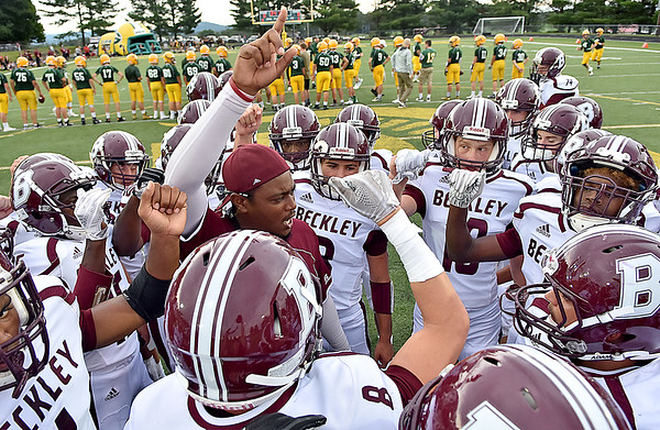(Brad Davis/The Register-Herald) Woodrow Wilson players get fired up Friday night in Fairlea.