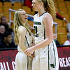 (Brad Davis/The Register-Herald) Wyoming East senior Gabby Lupardus congratulates teammate Emily Saunders as the Lady Warriors celebrate their State Tournament win over Wayne Friday morning at the Charleston Civic Center.