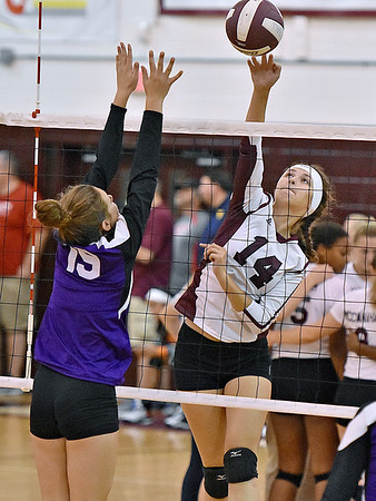 (Brad Davis/The Register-Herald) Woodrow Wilson's Emily Martin spikes the ball past Riverside's Emma Pauley during Shirley Brown Invitational action Saturday morning at Woodrow Wilson High School.