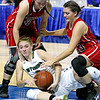 (Brad Davis/The Register-Herald) Wyoming East's Kara Sandy battles for a loose ball with Wayne's Aerial Adkins, right, and Lakyn Adkins Friday morning at the Charleston Civic Center.