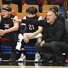 Greater Beckley Christian head coach Brian Helton, points out instruction to his team against Tug Valley during the quarter-final game of the Class A Boys State Basketball Tournament held at the Charleston Civic Center. Tug Valley won 83-52<br /> (Rick Barbero/The Register-Herald)