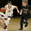 (Brad Davis/The Register-Herald) Woodrow Wilson's Bryce Radford hustles up the court as Riverside's Gage Lanham defends Wednesday night at the Beckley-Raleigh County Convention Center.