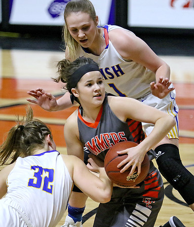 (Brad Davis/The Register-Herald) Summers County's Taylor Isaac gets caught in a scrum for a loose ball with St. Joseph Central's Paige Shy, left, and Bailee Adkins Friday night at the Charleston Civic Center.