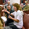 (Brad Davis/The Register-Herald) Minden resident Kristine Gilkey (holding microphone) appeals for help to officials on hand during the Q&A portion of a public meeting between town residents and representatives from state and federal agencies tasked with investigating the presence of PCB's there Friday night at New Beginning Apostolic Church.
